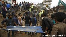 25.4.2015 *** Rescue workers search for bodies as a stretcher is kept ready after an earthquake hit, in Kathmandu, Nepal April 25, 2015. The powerful earthquake struck Nepal and sent tremors through northern India on Saturday, killing hundreds of people, toppling an historic 19th-century tower in the capital Kathmandu and touching off a deadly avalanche on Mount Everest. REUTERS/Navesh Chitrakar