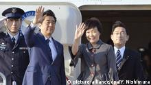 Shinzo Abe with his wife Akie waves as they board plane for US Photo: Yohei Nishimura/Kyodo News via AP