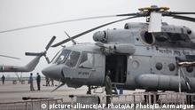 26. April 2015 An Indian army helicopter is parked on the tarmac of the Kathmandu international airport the day after a massive earthquake devastated the region, in Kathmandu, Nepal, Sunday, April 26, 2015. Indian air force planes landed Sunday with 43 tons of relief material, including tents and food, and nearly 200 rescuers, India's External Affairs Ministry spokesman Vikas Swarup said. The planes were returning to New Delhi with Indian nationals stranded in Kathmandu. (AP Photo/Bernat Armangue)