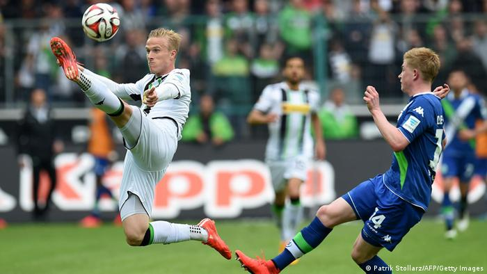 Gladbach player fights for the ball against Wolfsburg