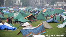 27.04.2015+++ Nepalese people gather near temporary shelters set up in open areas of an Army ground in Kathmandu on April 27, 2015, two days after a 7.8 magnitude earthquake hit Nepal. International aid groups and governments intensified efforts to get rescuers and supplies into earthquake-hit Nepal on April 26, but severed communications and landslides in the Himalayan nation posed formidable challenges to the relief effort. AFP PHOTO / PRAKASH MATHEMA (Photo credit should read PRAKASH MATHEMA/AFP/Getty Images)