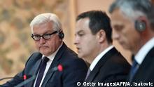 April 28, 2015 Bildunterschrift:German Foreign Minister Frank-Walter Steinmeier (L) listens to his Swiss counterpart and Serbian counterparts during a joint press conference after their meeting in Belgrade on April 28, 2015. AFP PHOTO / ANDREJ ISAKOVIC (Photo credit should read ANDREJ ISAKOVIC/AFP/Getty Images)