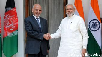 Indian Prime Minister, Narendra Modi (R), shakes hand with the Afghan President, Mohammad Ashraf Ghani during a meeting in New Delhi, India, 28 April 2015 (Photo: EPA/STR)