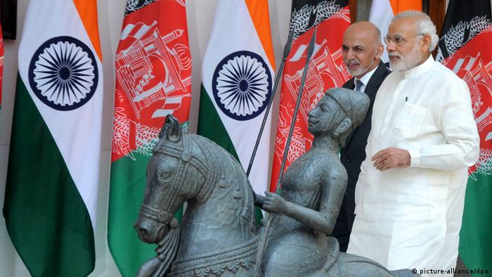 Indian Prime Minister, Narendra Modi (R), walks with the Afghan President, Mohammad Ashraf Ghani during their meeting in New Delhi, India, 28 April 2015 (Photo: EPA/STR)