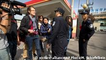 17.04.2015 *** China Journalist Sentenced Chinese policemen block journalists from approaching the Beijing No. 3 Intermediate Court in Beijing, Friday, April 17, 2015. Veteran Chinese journalist Gao Yu was sentenced to seven years in prison Friday for leaking a document detailing the Communist Party leadership's resolve to aggressively target civil society and press freedom as a threat to its monopoly on power. (AP Photo/Mark Schiefelbein)