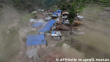 28.04.2015+++ Damaged houses are seen from an Indian Army helicopter at Lapu in the Nepalese area of Gorkha on April 28, 2015. Rescuers in Nepal battled April 28, 2015 to reach remote communities devastated by a huge earthquake that has killed at least 4,349 people, as the impoverished country's leader said relief workers had still not reached many of the worst-hit areas. AFP PHOTO / SAJJAD HUSSAIN (Photo credit should read SAJJAD HUSSAIN/AFP/Getty Images)