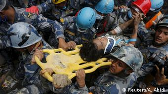 Earthquake survivor Pema Lama, 15, is rescued by the Armed Police Force from the collapsed Hilton Hotel, the result of an earthquake in Kathmandu, Nepal April 30, 2015 (Photo: REUTERS/Adnan Abidi)
