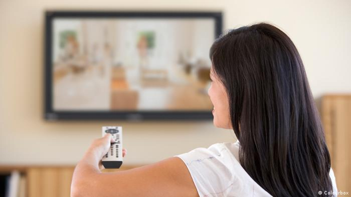 Woman watching TV, Copyright: Colourbox