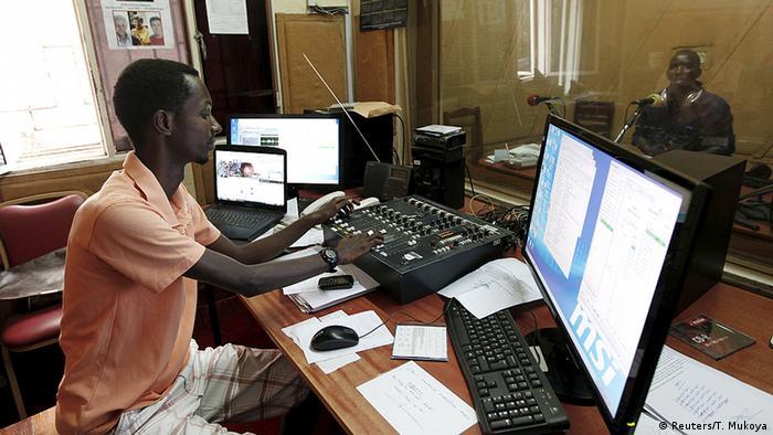 Two RPA journalists prepare a radio program in their studio. Photo: REUTERS/Thomas Mukoya
