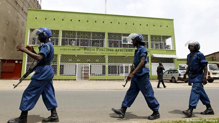 Armed police in riot gear walk in front of the shuttered RPA broadcasting studio. Photo: REUTERS/Thomas Mukoya
