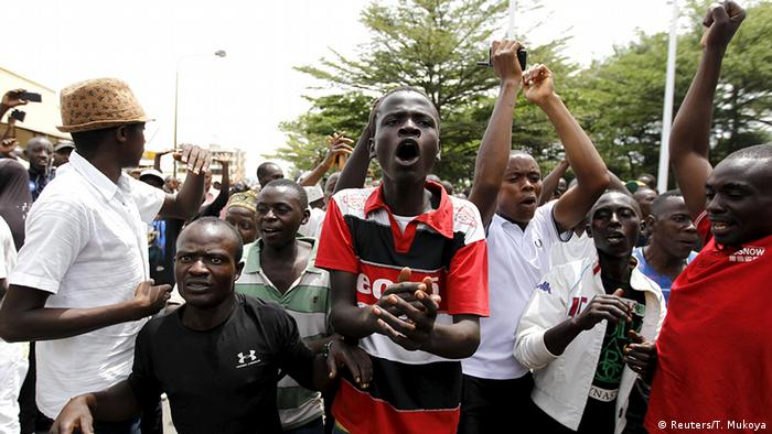 People cheer and dance during protests. Photo: REUTERS/Thomas Mukoya