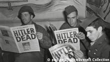U.S. Soldiers read of Hitler's death in an 'Extra' edition of 'Starts and Stripes', May 2, 1945. The combat soldiers were at the Rainbow Corner Red Cross Club in Paris. World War 2. (BSLOC_2014_8_103)