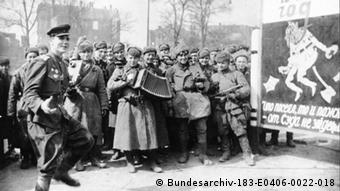 Red Army soldiers dance on the street in Berlin