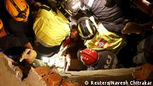 30.04.2015+++ Earthquake survivor Krishna Kumari Khadka, 24, is rescued by joint rescue team members from Norway, France and Israel after Saturday's earthquake, in Kathmandu, Nepal April 30, 2015. REUTERS/Navesh Chitrakar