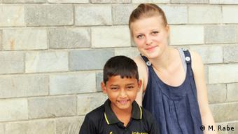 Milena Rabe and a school boy in Nepal