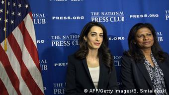 Lawyer Amal Clooney (L) and Laila Ali, wife of Mohamed Nasheed, sit together after a press conference at the National Press Club April 30, 2015 in Washington, DC, regarding attempts to get Ali's husband Nasheed released from prison (Photo: BRENDAN SMIALOWSKI/AFP/Getty Images)