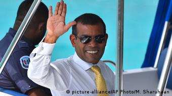 Maldives former President Mohamed Nasheed waves sitting in a boat as he is taken back to Dhoonidhoo prison after a court dismissed his appeal against his arrest in Male, Maldives. Maldives' jailed ex-president will not appeal his 13-year sentence because the court has not released all documents from the first hearing to prepare a case, his lawyer said Wednesday (AP Photo/ Mohamed Sharuhaan, File)