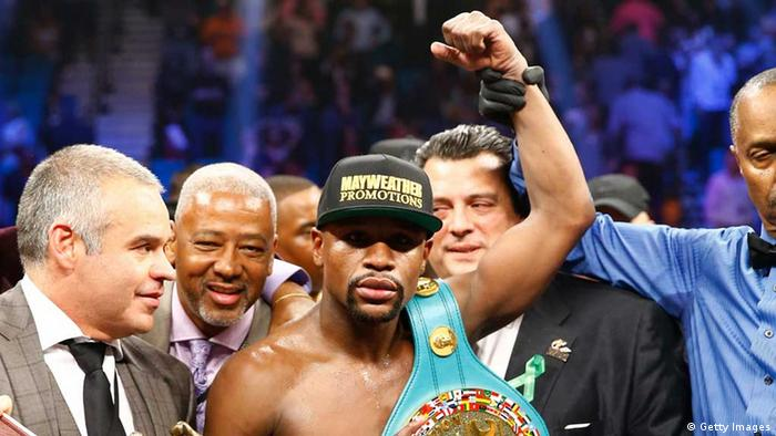 Floyd Mayweather Jr. celebrates the unanimous decision victory during the welterweight unification championship bout