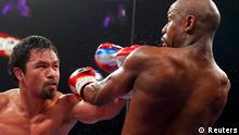 Manny Pacquiao lands a punch against Floyd Mayweather
