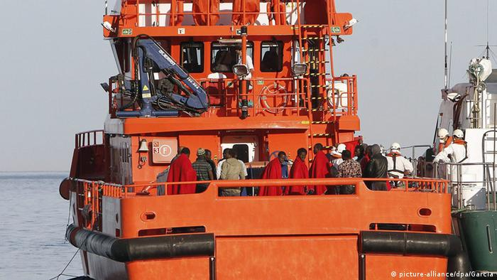 A ship carrying refugees docks.