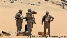 April 21, 2015 Saudi soldiers prepare to fire artillery towards the border with Yemen in Najran, Saudi Arabia, Tuesday, April 21, 2015. (AP Photo/Hasan Jamali)