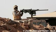 April 21, 2015 A Saudi soldier sits on top of an armor vehicle as he aims his weapons, on the border with Yemen, at a military point in Najran, Saudi Arabia, Tuesday, April 21, 2015. (AP Photo/Hasan Jamali)
