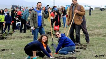 Photo: A group of people plant trees (Source: CTP)