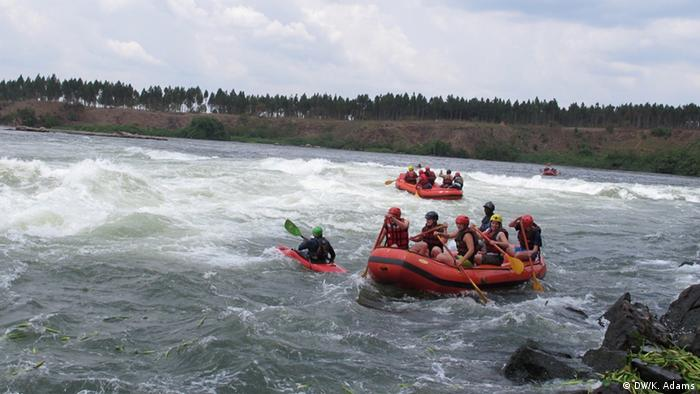 Tourists whitewater rafting in Uganda along the Nile