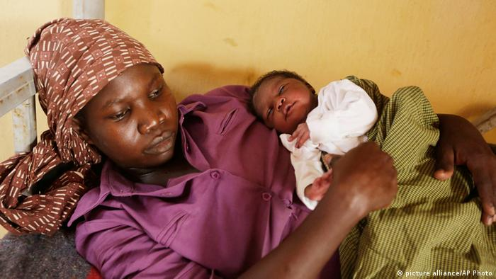 Lami Musa, who says her husband was killed before she was abducted by Islamist extremists, cradles her 5-day-old baby girl at a refugee camp clinic after she and others were rescued by Nigerian soldiers from Sambisa Forest, Yola, Nigeria Monday, May 4, 2015.