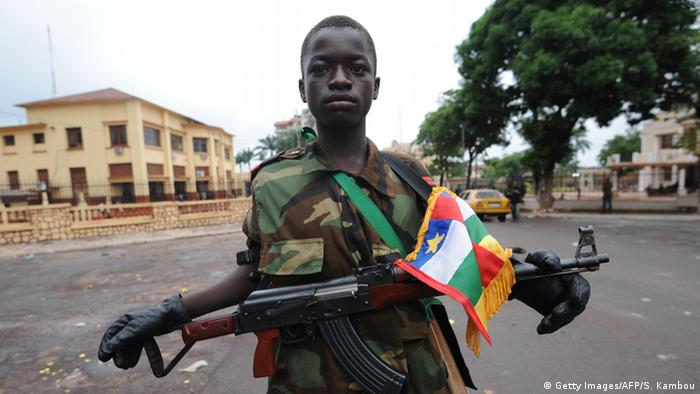 A very young Seleka coalition rebel poses near the presidential palace in Bangui. Photo: AFP PHOTO / SIA KAMBOU (Photo credit should read SIA KAMBOU/AFP/Getty Images)