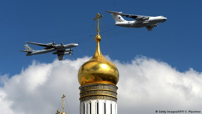 Russian military planes fly above the Kremlin's cathedrals