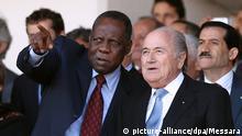 ARCHIV - FIFA President Joseph Blatter (R) talks with FIFA vice-president and Confederation of African Football (CAF) president Issa Hayatou (L) during the Algerian Cup final match between CR Belouizdad and ES Sétif at the 5 juillet Stadium in Algiers, Algeria on 01 May 2012. EPA/MOHAMED MESSARA (zu dpa-Meldung: «Neue Vorwürfe, alter Kern: FIFA und WM-Gastgeber wieder in der Kritik» vom 05.05.2015) +++(c) dpa - Bildfunk+++