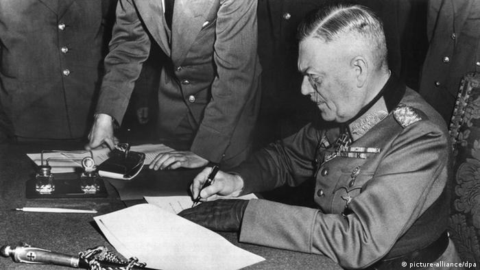 Field Marshall Wilhelm Keitel signs the capitulation in Berlin shortly after midnight local time on May 9