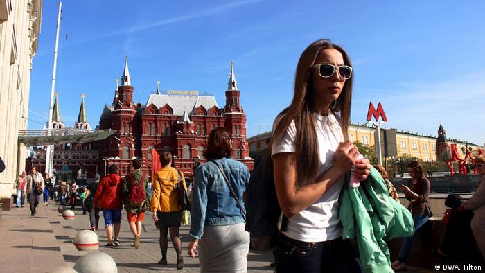 A woman in front of the Kremlin