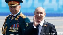 Vladimir Putin with Russian Defense Minister Sergei Shoigu in Moscow