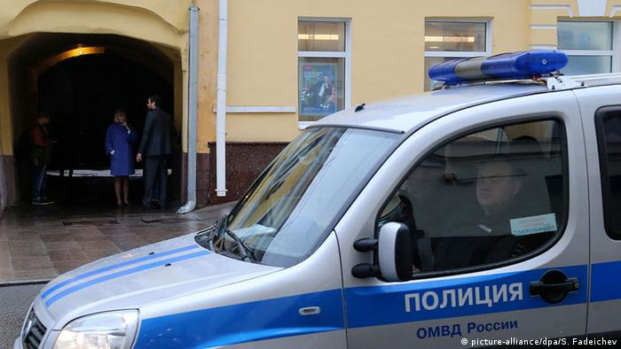 A Russian police car is seen outside an office in Moscow
