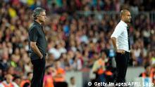Fußball Trainer Jose Mourinho und Josep Guardiola