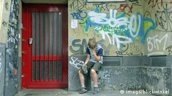 child sitting on wall