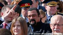 09.05.2015 *** epa04740050 US actor Steven Seagal (C) watch the Victory Day Parade in the Red Square in Moscow, Russia, 09 May 2015. The Victory Day parade on 09 May 2015 marks the 70th anniversary since the capitulation of Nazi Germany. EPA/SERGEI ILNITSKY