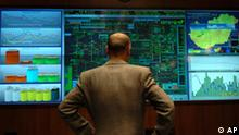 An engineer of Hungarian Oil and Gas Company MOL Rt. looks at the screens at the company's natural gas operation center in Siofok, 120 km southwest of Budapest, Hungary, on Tuesday, Jan. 3, 2006. Supplies of natural gas imported from Russia were back to normal levels, Hungarian gas and oil company MOL Rt. said Tuesday. Russia is providing us with the full amount we agreed upon in our contracts, MOL Rt. spokesman Sandor Kantor said. (AP Photo/Bela Szandelszky)