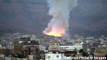 11.05.2015 *** Smoke billows following an air-strike by Saudi-led coalition on May 11, 2015, in the capital Sanaa. The raid targeted an arms depot in the Mount Noqum area on the eastern outskirts of Sanaa, triggering several blasts, an AFP correspondent and witnesses said. AFP PHOTO / MOHAMMED HUWAIS (Photo credit should read MOHAMMED HUWAIS/AFP/Getty Images)