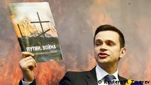 12.05.2015 *** Opposition activist Ilya Yashin speaks to the media during a presentation of the report about Russian military presence in Ukraine that murdered opposition leader Boris Nemtsov was working on shortly before his death, in Moscow, Russia, May 12, 2015. Moscow spent more than 53 billion roubles ($1.04 billion) supplying a separatist rebellion in east Ukraine and at least 220 Russian soldiers have been killed there, a report by Russian opposition activists said on Tuesday. REUTERS/Maxim Zmeyev