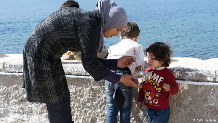 Latifah Abouras feeds her son