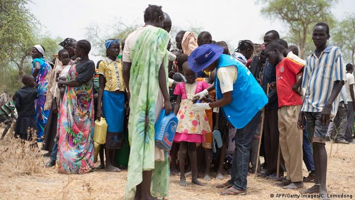 Internally displaced persons being registered