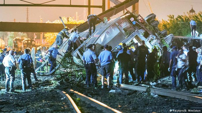 Emergency responders search for passengers following an Amtrak train derailment in the Frankfort section of Philadelphia, Pennsylvania, May 12, 2015.
