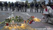 11.05.2015 *** A woman lights a candle to commemorate policemen who were killed in a gun battle, during a memorial in Skopje, Macedonia, May 11, 2015. Macedonia's government said eight police and 14 members of an armed group had been killed in a day-long gun battle through Saturday and into Sunday, at a moment of deep political crisis in the former Yugoslav republic. REUTERS/Marko Djurica