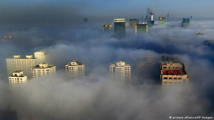 High-rise buildings and skyscrapers are vaguely seen in heavy smog in Shenyang city, northeast China