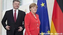 RELIFE CORRECTING INDENTIFYING SLUG German Chancellor Angela Merkel and Ukraine's President Petro Poroshenko, arrive for a joint press conference after a meeting at the Chancellery in Berlin, Germany, May 13, 2015. German Chancellor Angela Merkel said on Wednesday ahead of talks with Ukrainian President Petro Poroshenko that an agreed ceasefire between Kiev and Moscow was still being violated on a regular basis. REUTERS/Axel Schmidt