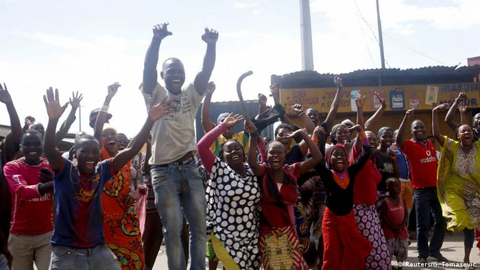People celebrate in a street in Bujumbura