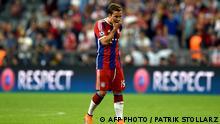 Bayern Munich's midfielder Mario Goetze reacts after the UEFA Champions League football match second leg semi final FC Bayern Munich vs FC Barcelona in Munich on May 12, 2015. AFP PHOTO / PATRIK STOLLARZ (Photo credit should read PATRIK STOLLARZ/AFP/Getty Images)